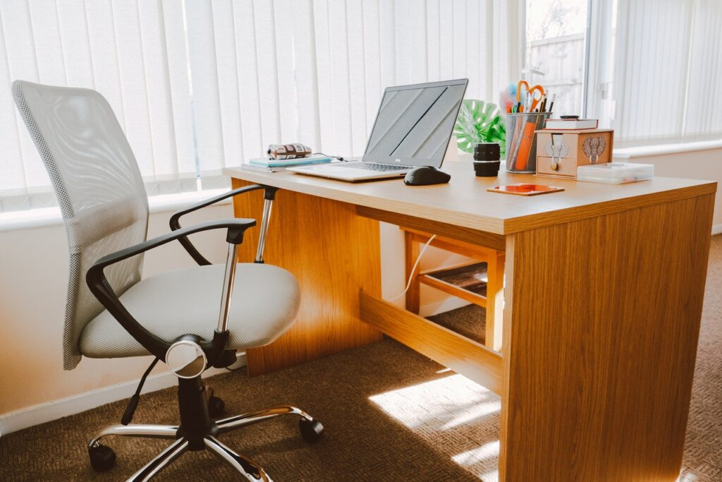 a small office table and a chair.
