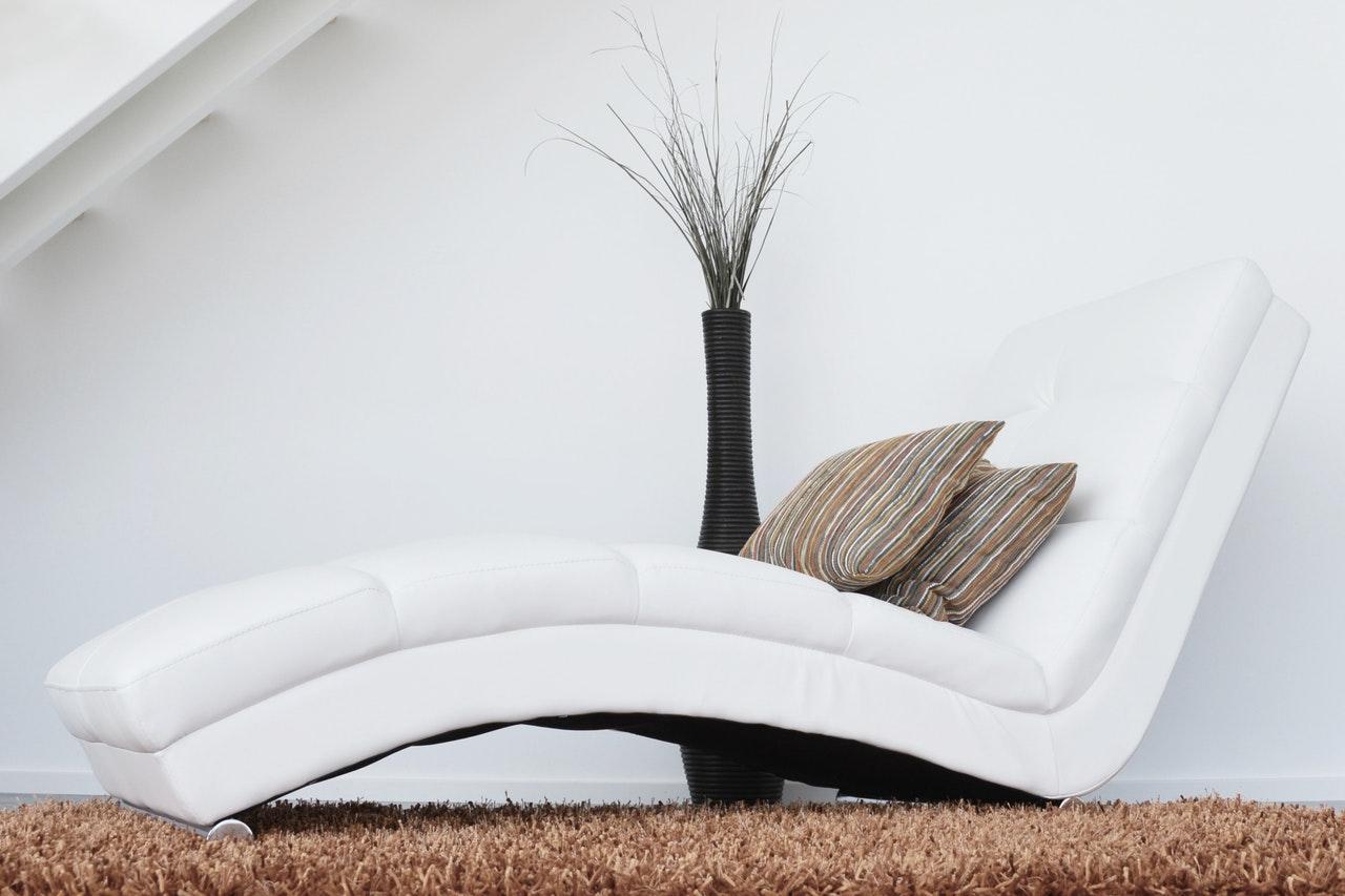 an s-shaped sofa/coach