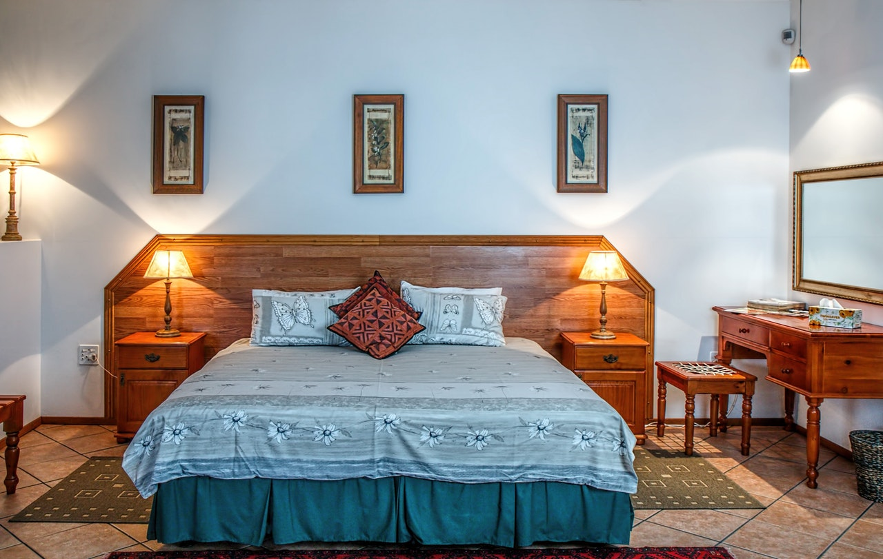 a bedroom with a comfortable bed with the best headboard