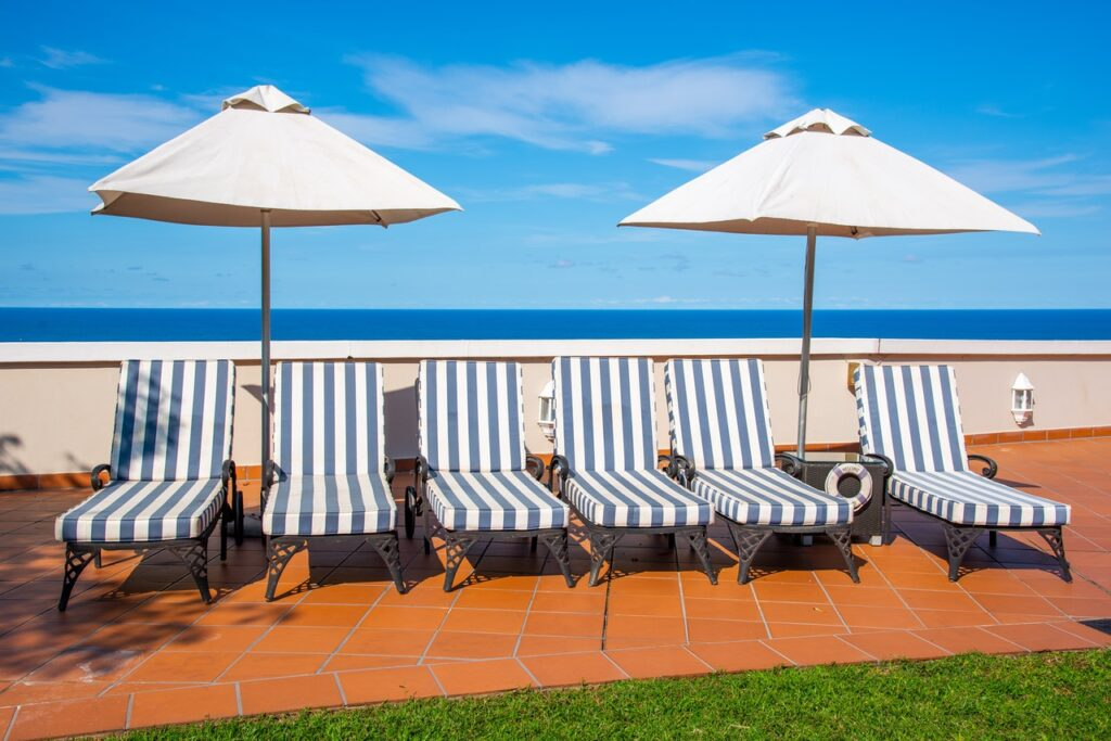 Chaise/Chez lounges and umbrellas