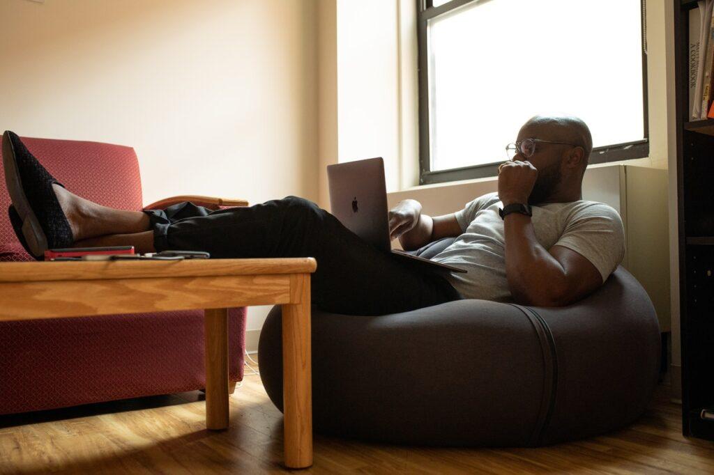 a man sitting in an air office chair