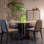 A dining room with a table and chairs