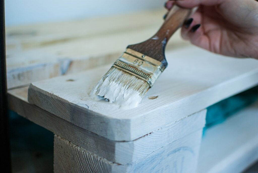 A person painting furniture