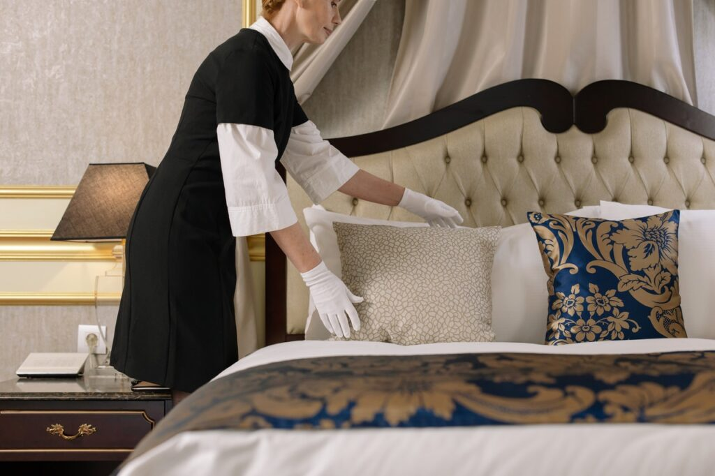 A woman cleaning her bedroom