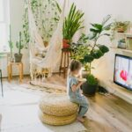 A living room setup/ a baby sitting on a coffee table